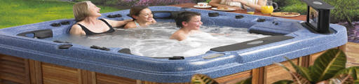 family enjoying hot tub in Scotland